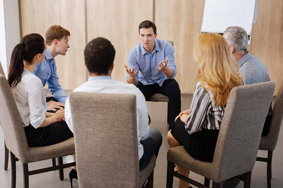 Addiction rehab usually includes group sessions.